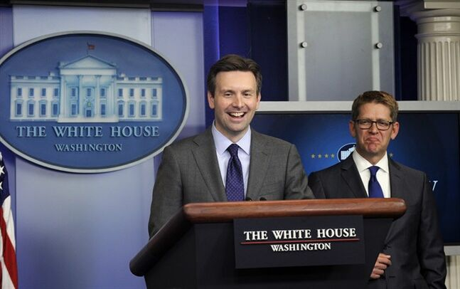 White House press secretary Jay Carney listens at right as Principal Deputy press secretary Josh Earnest takes to the stage for part of the daily briefing at the White House in Washington, Friday, May 30, 2014. Earlier, President Barack Obama made a surprise visit at the briefing to announce that Carney will be stepping down and his successor will be Earnest. (AP Photo/Susan Walsh)