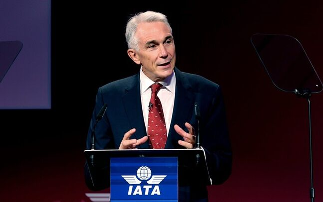 International Air Transport Association director Tony Tyler speaks during the the IATA's annual meeting held this year in Doha, Qatar, Monday, June 2, 2014. Tyler says the group will prepare a draft of new recommendations in September to improve global tracking capabilities in the aftermath of the disappearance of Malaysia Airlines Flight 370. (AP Photo/Osama Faisal)