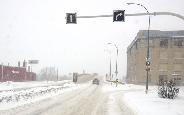 Roads are snow-covered and visibility is poor in Brandon today.