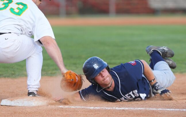 Reston Rockets' Andrew Lougheed beats the pick-off throw to first during Wednesday night's MSBL playoff game against the Brandon Cloverleafs at Andrews Field. The Cloverleafs won 4-1.