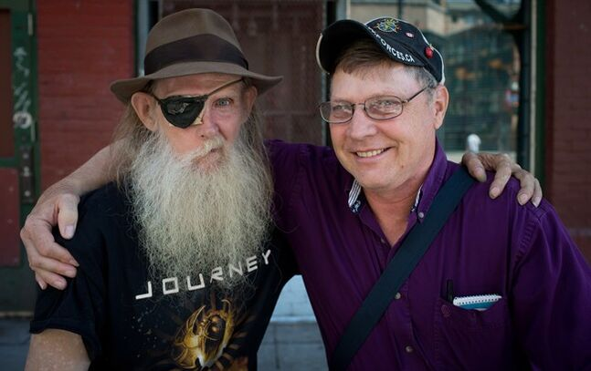 Brothers Bruce Sauer, left, who lives in Vancouver's Downtown Eastside and wears an eye patch because of Bell's Palsy, and his brother Bill Olsen, of Edmonton, Alta., sit for a photograph together in Vancouver, B.C., on Sunday July 13, 2014. The Calgary-raised brothers lost contact and hadn't seen or heard from each other for 13 years when Bill saw a Canadian Press feature on residents of the Downtown Eastside last year and spotted a photo of Bruce. The two were able to meet this past weekend when Bill drove to Vancouver from Edmonton to see his brother. THE CANADIAN PRESS/Darryl Dyck