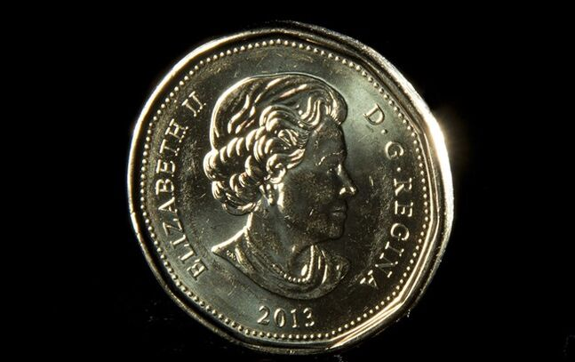 A loonie is pictured in North Vancouver Dec.31, 2013. THE CANADIAN PRESS/Jonathan Hayward