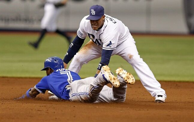 Tampa Bay Rays shortstop Yunel Escobar tags out Toronto Blue Jays' Jose Reyes at second base during the fifth inning of a baseball game Saturday, July 12, 2014, in St. Petersburg, Fla. (AP Photo/Mike Carlson)
