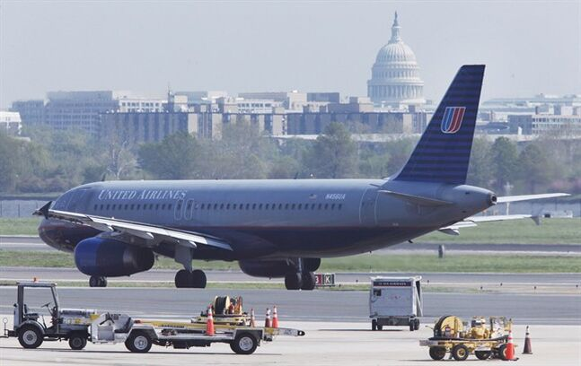The U.S. Capitol backdrops a United Airlines plane as it taxis on the runway of Washington's Ronald Reagan Washington National Airport, on April 8, 2010. THE CANADIAN PRESS/AP, Manuel Balce Ceneta