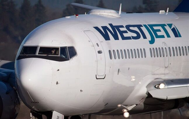 A pilot taxis a Westjet Boeing 737-700 to a gate in Vancouver on February 3, 2014. THE CANADIAN PRESS/Darryl Dyck
