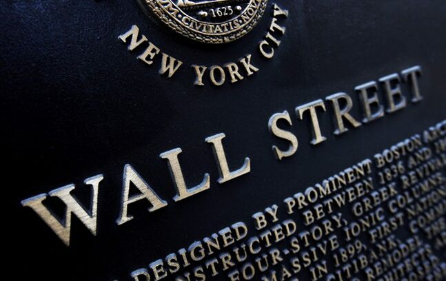 FILE - This Jan. 4, 2010 file photo shows an historic marker on Wall Street in New York. The U.S. stock market crept up in midday trading Thursday, Aug. 14, 2014, following a mixed batch of corporate news. (AP Photo/Mark Lennihan, File)