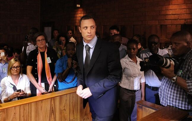 FILE - In this Feb. 22, 2013 file photo, Olympic athlete Oscar Pistorius arrives for a bail hearing in the shooting death of his girlfriend, Reeva Steenkamp. Pistorius' representatives on Wednesday, Feb. 27, 2013 named the substance found in his bedroom after the shooting death of his girlfriend as Testis compositum, and say it is an herbal remedy used