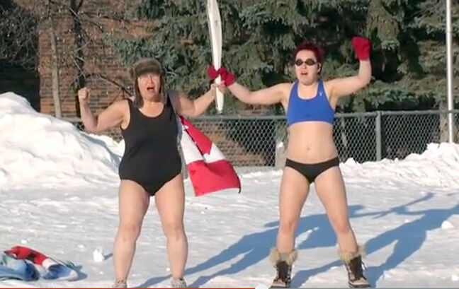 Brandon's winter-defying granny, Kim Bright, holds an Olympic torch with her daughter in her latest YouTube video.