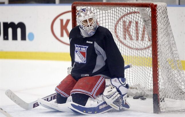 New York Rangers goalie Henrik Lundqvist, of Sweden, sits in the crease during a break in the action of a team practice at the Rangers training facility in Greenburgh, N.Y., Sunday, June 1, 2014. The Rangers will face the winner of Sunday's Western Conference Finals between the Los Angeles Kings and the Chicago Blackhawks. (AP Photo/Kathy Willens)
