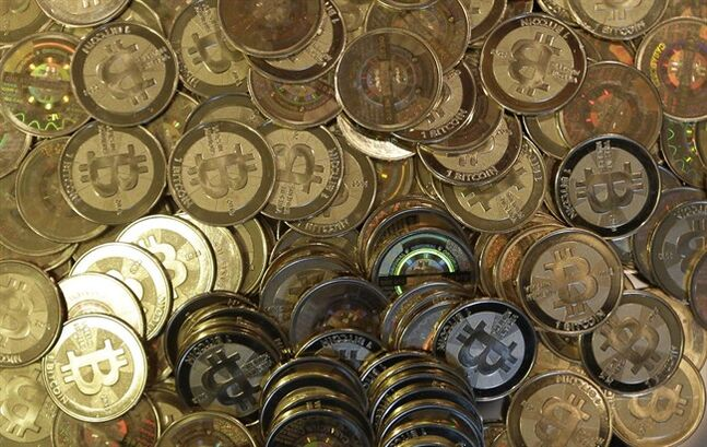 This April 3, 2013 file photo shows bitcoin tokens in Sandy, Utah. A small but growing ??? and surprising ??? number of workers are rejecting Canadian dollar salaries for Bitcoin, according to a Waterloo, Ont., payroll firm. THE CANADIAN PRESS/AP/Rick Bowmer