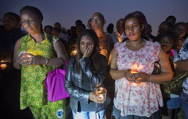 People attend a vigil in memory of the victims of Algeria flight AH5017 at a park in Longueuil, Que., Friday, July 25, 2014. THE CANADIAN PRESS/Graham Hughes