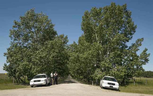 RCMP officers guard an entrance as police continue to search a property northeast of Airdrie, Alta., Wednesday, July 9, 2014. Investigators are looking for clues to the disappearance of a five-year-old boy and his grandparents. THE CANADIAN PRESS/Jeff McIntosh