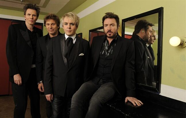 "FILE - In this March 23, 2011 file photo, from left, Duran Duran members John Taylor, Roger Taylor, Nick Rhodes and Simon Le Bon pose together backstage before a concert at The Mayan Theatre in Los Angeles. Along with work to finish a new album, the ageless British rock band will appear at the Sept. 9, 2014 ""Fashion Rocks"" event before releasing ""Duran Duran: Unstaged"" in more than 300 North American theaters on Sept. 10. (AP Photo/Chris Pizzello, File)"