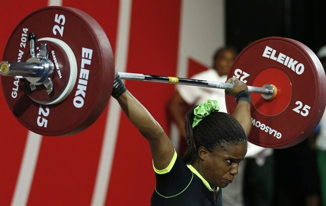 Chika Amalaha of Nigeria lifts in the women's 53 kg weightlifting competition at the Commonwealth Games Glasgow 2014. THE CANADIAN PRESS/AP, Alastair Grant