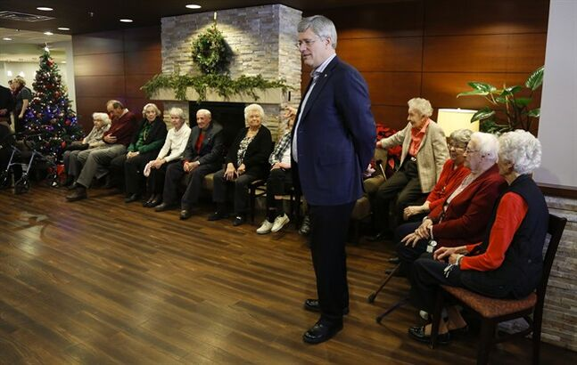 Prime Minister Stephen Harper meets with residents at the Garrison Green Seniors Community in Calgary, Alta., Sunday, Dec. 22, 2013. THE CANADIAN PRESS/Jeff McIntosh