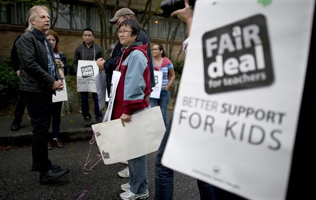 British Columbia Teacher Federation (BCTF) President Jim Iker is seen outside the Britannia Secondary and Elementary Schools in Vancouver, Tuesday, Sept. 2, 2014, prior to speaking to the media regarding the ongoing teachers strike. THE CANADIAN PRESS/Jonathan Hayward