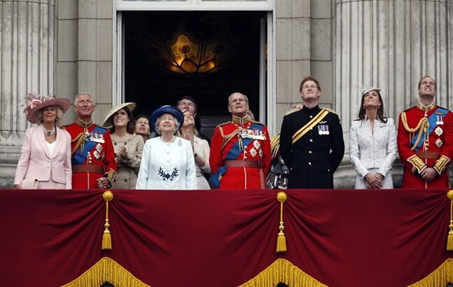 FILE - In this Saturday, June 14, 2014 file photo, Britain's Queen Elizabeth II, foreground, surrounded by members of her family, stands on the balcony of Buckingham Palace to watch the Royal Air Force fly past, during the Trooping The Colour parade, in central London. Buckingham Palace says the monarchy cost British taxpayers 35.7 million pounds ($60.8 million) last year — 56 pence (just under $1) for everyone in the country. More than a third of the money was spent on repairs and maintenance to aging palaces, and some 3.4 million pounds was spent in the year to March 31, 2014 refurbishing part of London's Kensington Palace into a home for Prince William, his wife Catherine and their toddler son Prince George. As the accounts were published Thursday, June 26, 2014, Keeper of the Privy Purse Alan Reid said the royal household was keen to