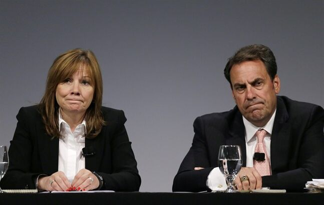General Motors CEO Mary Barra, and Executive Vice President Mark Reuss, hold a news conference at the General Motors Technical Center in Warren, Mich., Thursday, June 5, 2014. Barra said 15 employees — many of them senior legal and engineering executives — have been forced out of the company for failing to disclose a defect with ignition switches, which the company links to 13 deaths. Five other employees have been disciplined. (AP Photo/Carlos Osorio)