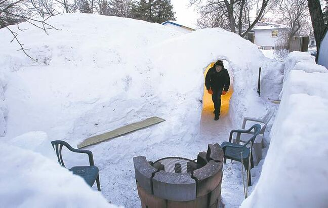 WAYNE GLOWACKI / WINNIPEG FREE PRESS  The architecture graduate's snow house features an outdoor patio. When it melts, the runoff will drain into the Red River.