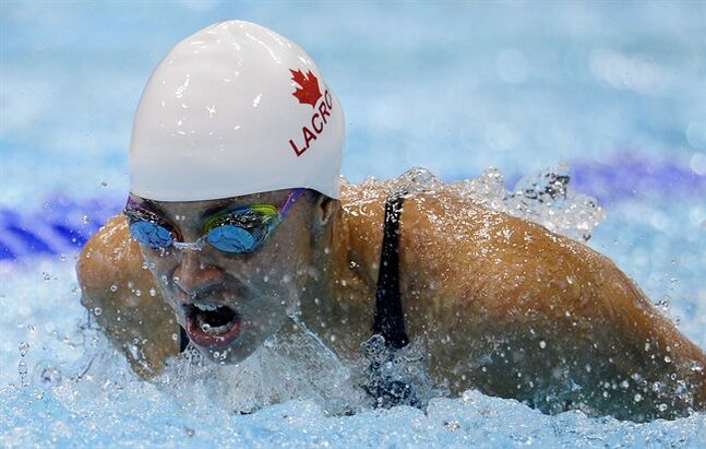Canada's Audrey Lacroix competes in a women's 200-meter butterfly heat at the 2012 Summer Olympics in London on Tuesday, July 31, 2012. Lacroix is back in form at the Commonwealth Games after dealing with anxiety. THE CANADIAN PRESS/Sean Kilpatrick