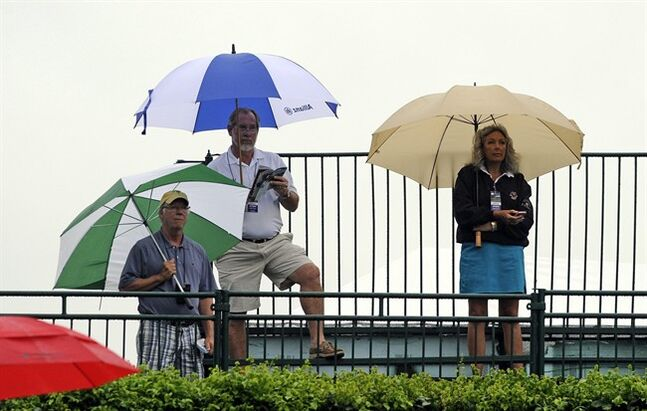 Spectators watch Brendan Steele tee off on the 10th tee during the first round of the Travelers Championship golf tournament in Cromwell, Conn., Thursday, June 19, 2014. (AP Photo/Fred Beckham)