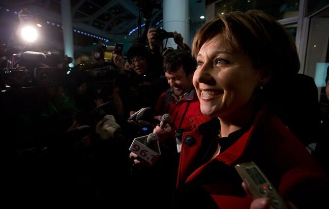 British Columbia Premier Christy Clark speaks to reporters after an emergency cabinet meeting in Vancouver on Sunday, March 3, 2013. Some members of B.C.'s governing Liberal party are publicly calling for Premier Christy Clark to resign over a scandal involving the wooing of ethnic voters. THE CANADIAN PRESS/Darryl Dyck