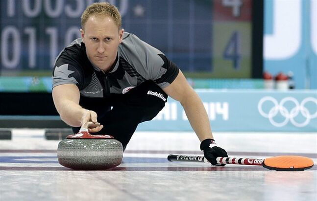 Canada's skip Brad Jacobs releases the rock during the men's curling competition against Britain at the 2014 Winter Olympics, Saturday, Feb. 15, 2014, in Sochi, Russia. (AP Photo/Wong Maye-E)
