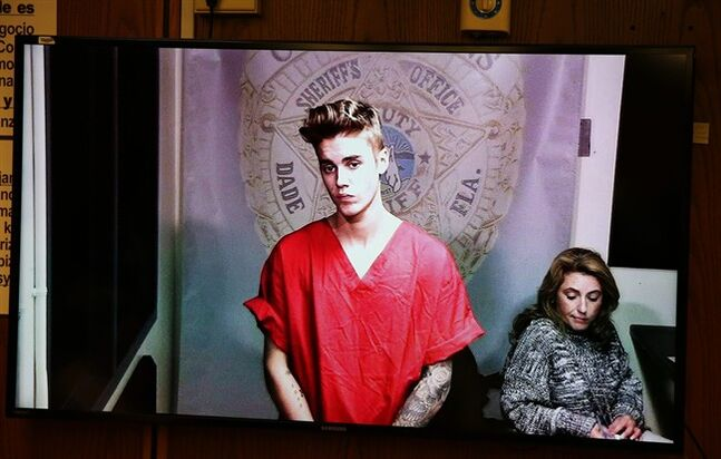 This Jan. 23, 2014 photo shows Justin Bieber appearing in court via video feed in Miami. THE CANADIAN PRESS/AP, The Miami Herald, Walter Michot