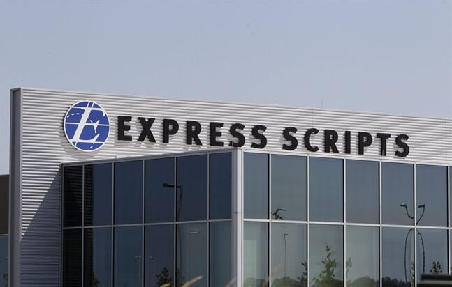 FILE - This July 21, 2011, file photo shows a building on the Express Scripts campus in Berkeley, Mo. Express Scripts Holding Co. reports quarterly financial results after the market closes on Thursday, Feb. 20, 2014. (AP Photo/Jeff Roberson, File)