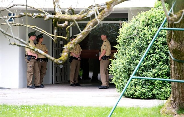 Police officers stand in front of a house where art collector Cornelius Gurlitt lived, in Munich, Germany, Tuesday, May 6, 2014. Gurlitt, a reclusive German collector whose long-secret hoard of well over 1,000 artworks triggered an international uproar over the fate of art looted by the Nazis, died Tuesday. He was 81.Photo (AP Photo/dpa, Sven Hoppe)