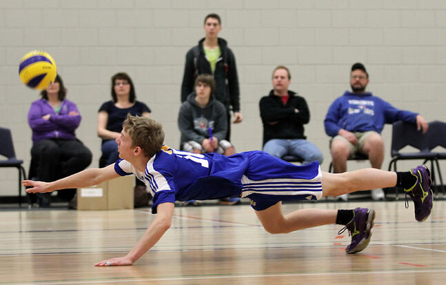Luke Giesbrecht of the Brandon Volleyball Club's 17U team dives for the ball during the fifth-place match against the Selkirk Royals at Brandon University's Healthy Living Centre on Sunday.