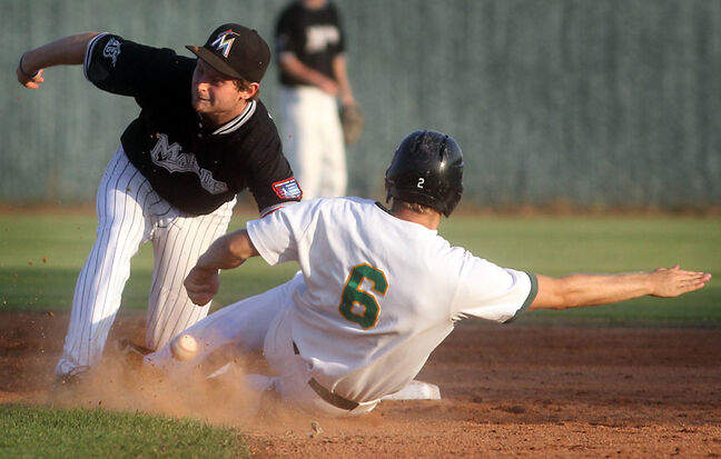 Brandon Cloverleafs' Derek Chapman slides safely into second as Brandon Marlins' Tanner Jago drops the ball on the tag during Thursday's MSBL playoff game at Andrews Field.