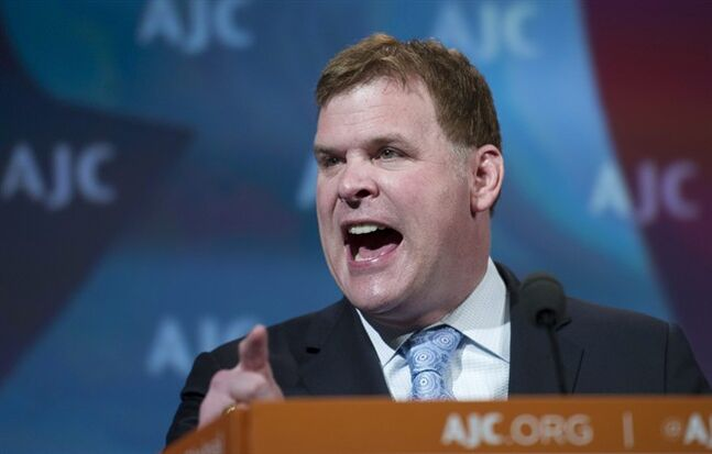 Canadian Foreign Minister John Baird gestures as he addresses the American Jewish Committee (AJC) Global Forum closing plenary in Washington, Wednesday, May 14, 2014. (AP Photo/Cliff Owen)