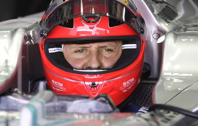 In this Nov. 23, 2012 photo, Michael Schumacher sits in his cockpit in Sao Paulo, Brazil. THE CANADIAN PRESS/AP, Victor Caivano