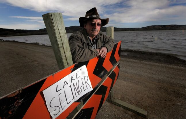 Gene Nerbas poses on a closed roadway just downstream of the Shellmouth Dam.