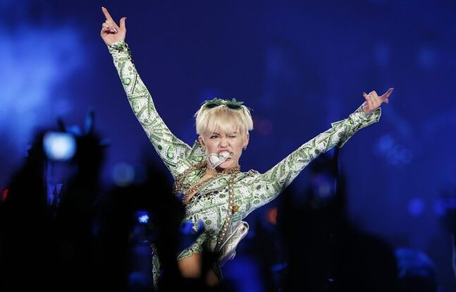 US singer Miley Cyrus, performs in concert on the UK leg of her Bangerz tour, at the O2 Arena, London, Tuesday, May 6, 2014. (AP Photo/PA, Jonathan Brady) UNITED KINGDOM OUT