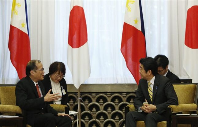 Philippine President Benigno Aquino III, left, talks with Japan's Prime Minister Shinzo Abe during their meeting at Abe's office in Tokyo Tuesday, June 24, 2014. (AP photo/Yuya Shino, Pool)