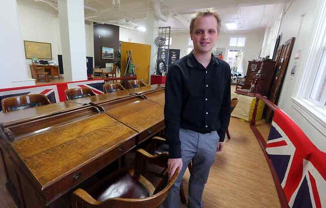 Brandon General Museum and Archives Inc. curator Mark Veneziano stands next to the original city council tables which are on display at the Ninth Street museum.