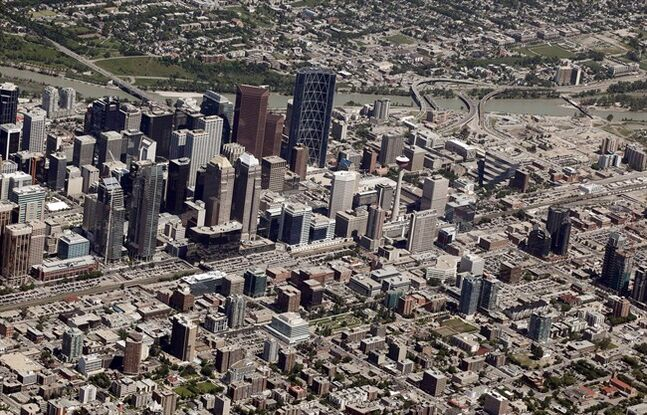 The downtown core is seen from the air in Calgary, Alta., Thursday, July 11, 2013. Alberta's biggest city just keeps getting bigger.The latest municipal census shows Calgary's population went up by 3.3 per cent, or more than 38,000, in 2013. THE CANADIAN PRESS/Jeff McIntosh