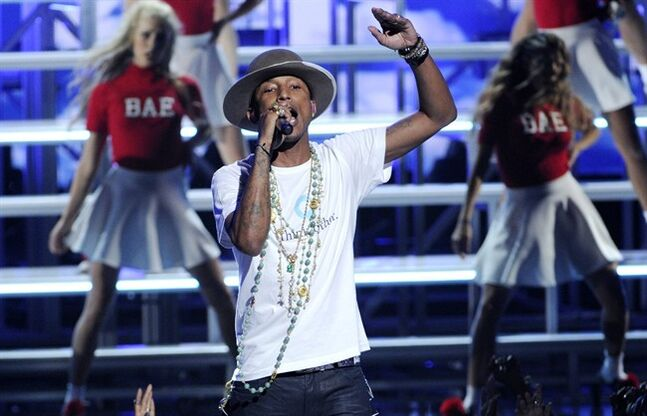 Pharrell Williams performs at the BET Awards at the Nokia Theatre on Sunday, June 29, 2014, in Los Angeles. (Photo by Chris Pizzello/Invision/AP)