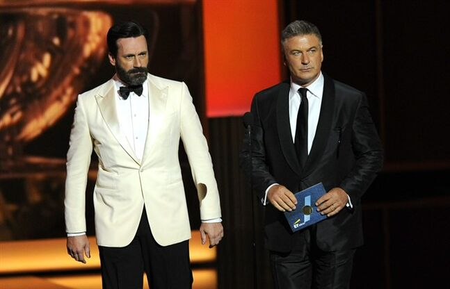 FILE - In this Sunday, Sept. 22, 2013 file photo, Jon Hamm, left, and Alec Baldwin present the award for outstanding lead actress in a comedy series on stage at the 65th Primetime Emmy Awards at Nokia Theatre, in Los Angeles. NBC and the TV academy said the ceremony honoring prime-time TV's best is set for Monday, Aug. 25, 2014. A host has not yet been announced. (Photo by Chris Pizzello/Invision/AP, File)
