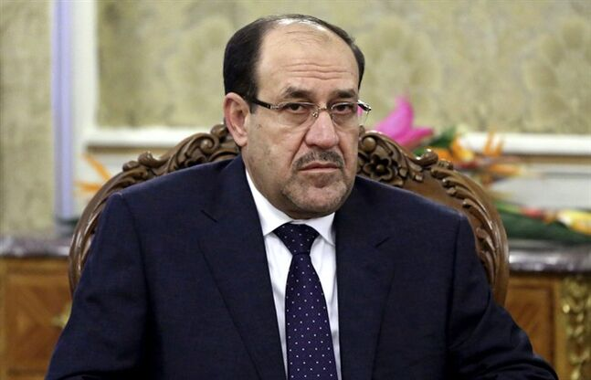 FILE - In this Thursday, Dec. 5, 2013 file photo, Iraqi Prime Minister Nouri al-Maliki meets with Iran's former President Akbar Hashemi Rafsanjani in Tehran, Iran. Iraqi security forces battled insurgents targeting the country's main oil refinery and claimed to regain partial control of a city near the Syrian border Wednesday, trying to blunt a weeklong offensive by militants who diplomats fear may have abducted some 100 foreign workers. Al-Maliki, meanwhile, struck an optimistic tone after soldiers abandoned their posts in the wake of the initial offensive, promising his nation would teach the attackers a