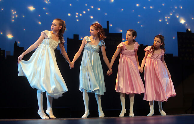 "The sisters — played by Jazmion Fraser Davie, Mia Visser, Anna Osterbeck and Caitlin Bossert — ponder while performing one of their numbers in the Brandon School of Dance's production of ""Christmas Dreams,"" last month at the Western Manitoba Centennial Auditorium."