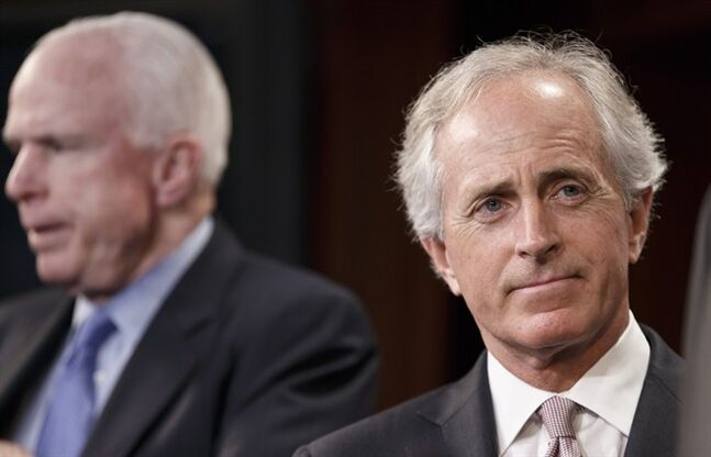 Sen. Bob Corker, R-Tenn., right, accompanied by Sen. John McCain, R-Ariz., listens during a news conference on Capitol Hill in Washington, Wednesday, April 30, 2014. Corker was the only Republican to cross party lines and vote