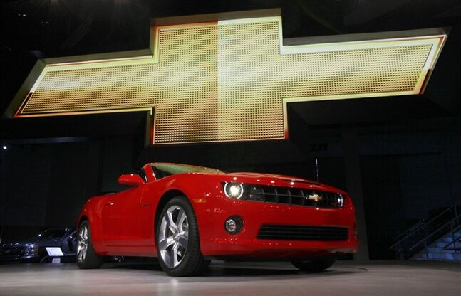 In this Wednesday, Nov. 17, 2010, file photo, the 2011 Chevrolet Camaro convertible debuts at the Los Angeles Auto Show. General Motors is recalling nearly 512,000 Chevrolet Camaro muscle cars from the 2010 to 2014 model years. A driver's knee can bump the key and knock the switch out of the