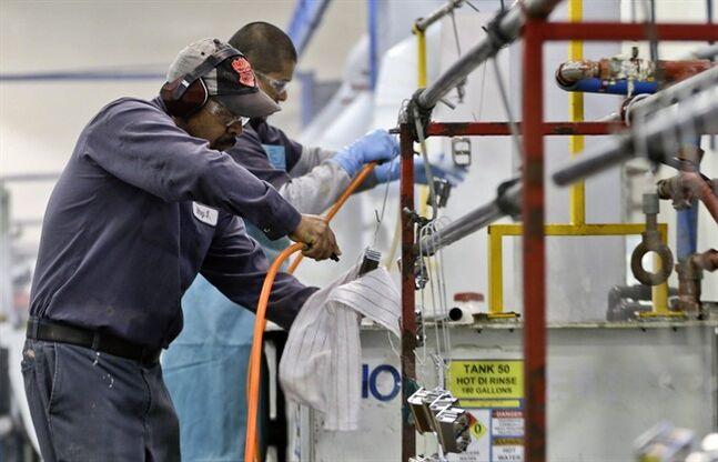 FILE - In this Thursday, Oct. 10, 2013, file photo, employees at Sheffield Platers Inc. work on the factory floor in San Diego. The Commerce Department releases fourth-quarter gross domestic product on Thursday, Jan. 30, 2014 (AP Photo/Lenny Ignelzi, File)