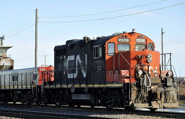 A CN locomotive goes through the CN Taschereau yard in Montreal, Saturday, Nov., 28, 2009. Canada's largest railway has received notice that one of its major unions could go on strike as early as Saturday. THE CANADIAN PRESS/Graham Hughes