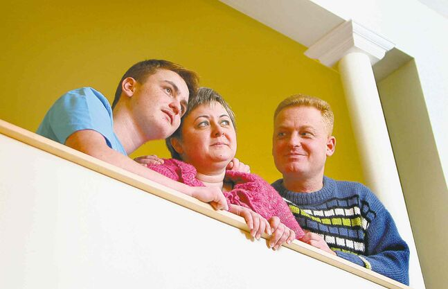 Dmitry Elyason (right) and Evgenia Malyarevsky, with son Danlei, left Israel 'for a peaceful life without rockets.'