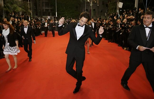 Actor Adrien Brody poses for photographers as he arrives for the screening of Coming Home (Gu Lai) at the 67th international film festival, Cannes, southern France, Tuesday, May 20, 2014. (AP Photo/Thibault Camus)
