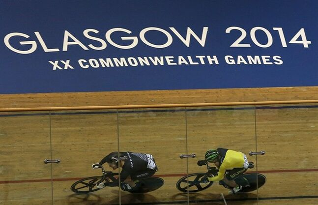 New Zealand's Sam Webster, left, leads Malaysia's Mohd Azizulhasni Awang, right, during the Men's sprint Quarter final at the Velodrome in Glasgow, Scotland, Friday, July 25, 2014. (AP Photo/Scott Heppell)